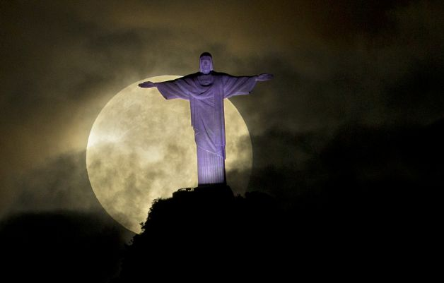 'Supermoon' shines bright over Rio's Christ the Redeemer statue, photo by AP.