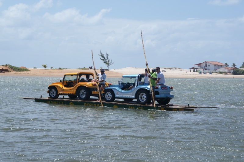 Ferrying dune buggies across a river near Genipabu. Photo by Ben Tavener.