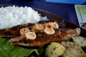 "Frigate-tuna, ""serra"" with prawn/shrimp garnish. Restaurant in Maracajaú, north of Natal. Photo by Ben Tavener."