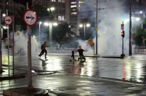 Police disperse protesters with tear gas and stun grenades. Photo by Ben Tavener.