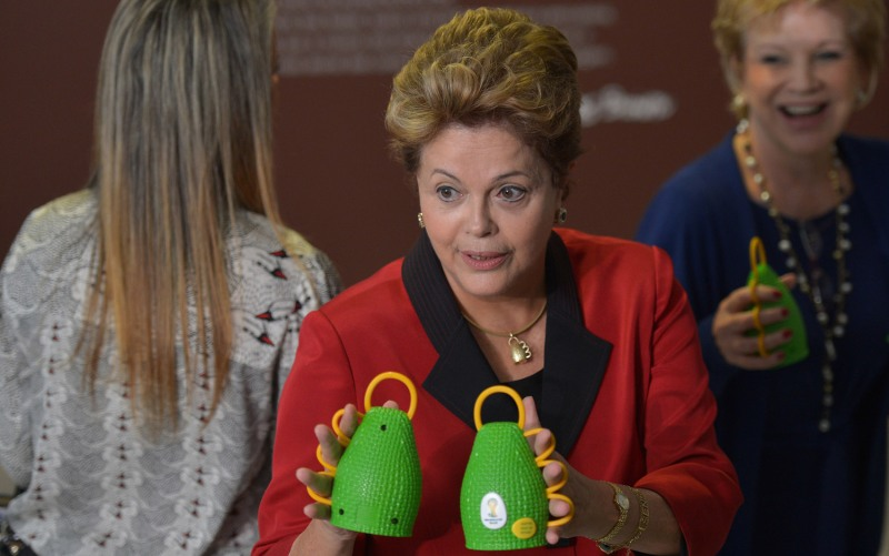 President Dilma Rousseff meets the Caxirola World Cup rattle